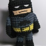 The Caped Crusader, but small and made of yarn.