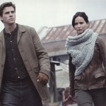 Katniss, sporting a stylish scarf/cowl.